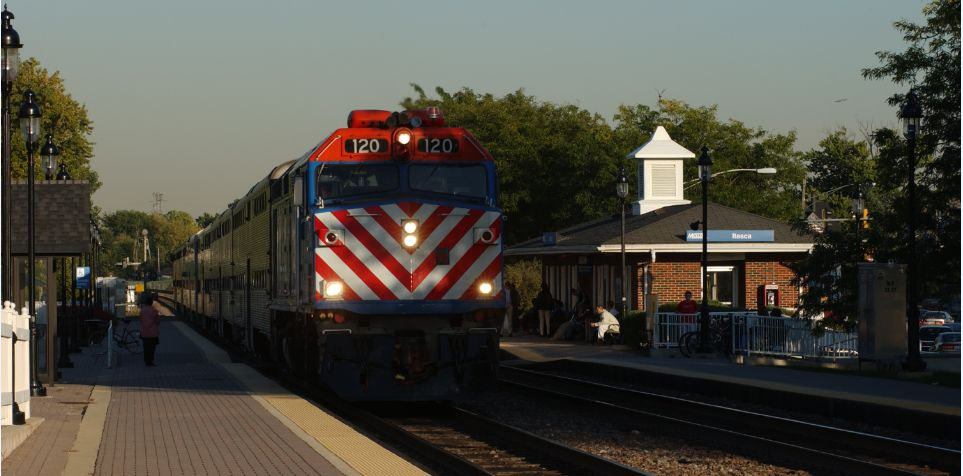 A train approaching a metra lot