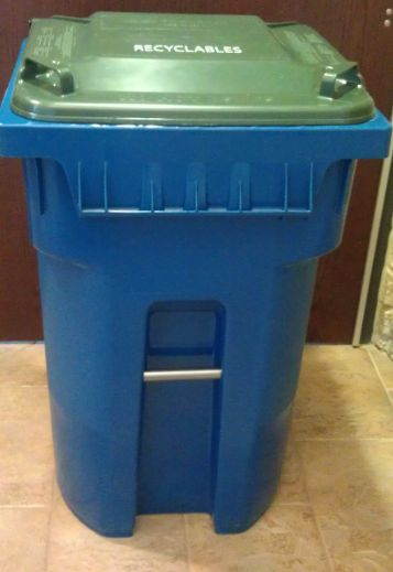 Recycling cart with a green lid
